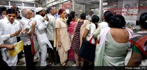 People Waiting in a Queue to Pay Bills